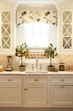 Carrera marble countertops and backsplash. Valance in a Crewel-work Fabric.