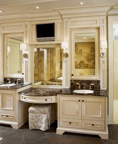 Built in vanity in walk in closet. Lovin' the TV too!