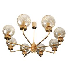 Kalmar Bronze and Glass Chandelier in the Stilnovo Style | From a unique collection of antique and modern chandeliers and pendants  at https://www.1stdibs.com/furniture/lighting/chandeliers-pendant-lights/