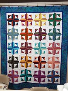 "Wonderful to see a lovely version of ""Robin's Rainbow"" from Happy Stash Quilts hanging in Bearly Quilting in Sonora, California."