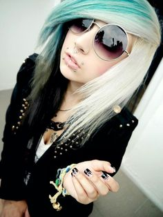 I want here canine bites and a septum piercing give her props on rocking the large sunglasses