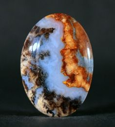 BLUE PLUME AGATE Gold colored Marcasite tipped Plumes Left Side of Cabochon in attractive blue chalcedony.