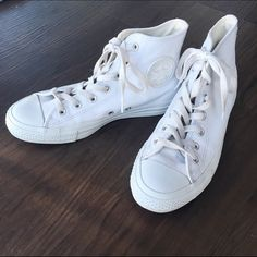 Chuck Taylor All Star Leather High Top Converse These incredible beauties by Converse are a must have for any closet. Pair with jeans or a spring dress for a stylish look. They are made with a leather upper and are in excellent condition with minimal signs of wear. Converse Shoes Sneakers
