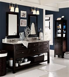 Navy and white with dark cabinets.  I love this for a crisp, clean, masculine bathroom.  White towels with navy monograms would be perfect.