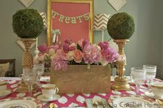 Interior designer, Amanda Eck, took gold candlesticks from HomeGoods and added large moss balls on top for a Bridal Shower tablescape.