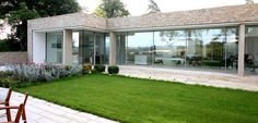 An elevation of sliding glass doors to underground home leading onto external garden courtyard