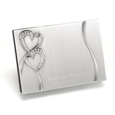 Sparkling Love Guest Book - Brushed silver-plated guest book with rhinestone-studded heart design and black velvet backing. Records 1,000 signatures.