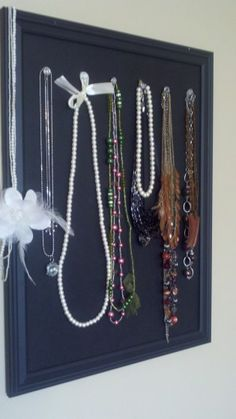 Cute and simple way to organize necklaces.