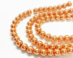 Check out Bulk pearls orange, 65 faux pearls, 6mm glass pearls, orange beads, faux pearls, colorful beads, jewelry making, craft supplies on vickysjewelrysupply