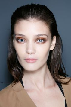 Backstage at Gucci Spring 2014 RTW at Milan Fashion Week - runway make-up.