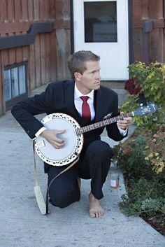 Dapper barefoot banjo wielding groom