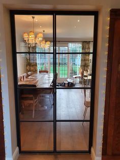 The metal framed doors can balance all sorts of interior decors. They look similar to the steel doors, but with their own benefits. Aluminium Glass Door, Indoor Glass Doors, Kitchen Dining Living, Living Room, Door Dividers, Double Glass Doors, Door Design Interior, Luxury Kitchen Design, Folding Doors