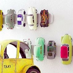 how cool: toy-cars on the wall with a magnatic-knife holder from Ikea!