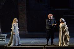 Rigoletto (Devid Cecconi) entrusting the daughter Gilda (Ekaterina Bakanova) to the governess Giovanna (Silvia Pasini).