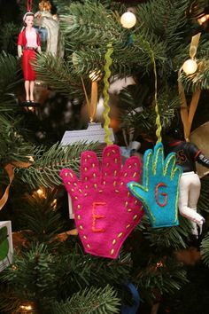 felt hand ornaments.  These would be cute to have the kids do to remember how small their hands were!