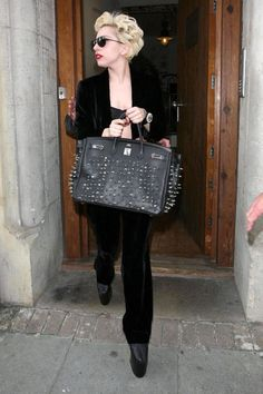 Lady Gaga's Birkin comes super-studded, for that avant-garde style the songstress is synonymous with.   - HarpersBAZAAR.com