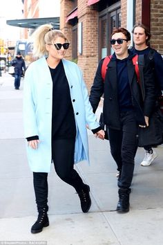 Happy together: Meghan Trainor, 24, was snapped in New York City on Wednesday with fiance ...