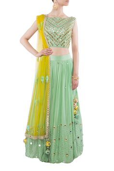Sea green mirror work lehenga by Kanika Chawla. Shop now: http://www.onceuponatrunk.com/designers/kanika-chawla #green #yellow #lehenga #floral #embroidery #sheer #fashion #beautiful #elegant #shopnow #kanikachawla #indianfashiondesigner #onceuponatrunk #happyshopping