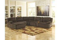 No need to sacrifice looks for comfort. The Toletta 6-piece sectional with power serves up both with a richly relaxed sense of style. Earthy upholstery is ultra soft with a plush, textured nap for an added layer of interest. Overstuffed pillow armrests are custom made for lazy afternoon catnaps. One-touch power control takes the pleasure of reclining to a higher level. Smart design includes zero-wall recliner, requiring minimal space clearance, and a handy console with storage and dual cup…