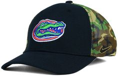 The Nike NCAA Camo Hook Swooshflex cap features the Florida Gators letters and nickname on the front and back to show your school support. The cool hat features a mesh camo rear half that looks good and provides ventilation whether you wear it on a hot summer day or cool autumn evening. Mid crown Structured fit Normal bill Raised embroidered team logo at front Flat embroidered team wordmark at back Stitched Nike swoosh at left side Stretch fitted Polyester/spandex Spot clean