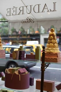 Laduree - Paris... How obvious but clever. Go inside to shot the window display and avoid the glare of the glass.