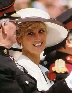 Diana in large white hat with what looks like chocolate trim