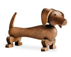 The Rosendahl Wooden Dachshund is one of a series of wooden animals designed by Kay Bojesen. For any dachshund or Danish design lover it's the perfect gift. Buy online from Utility design today. Animal Design, Dog Design, Design Shop, Design3000, Dog Milk, Wooden Figurines, Popular Toys, Wooden Animals, Dachshund Love