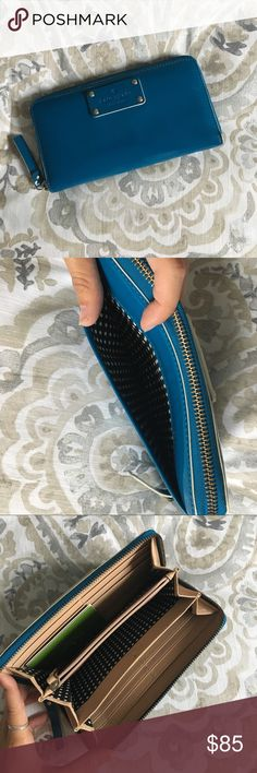 Kate Spade wallet Teal-blue Kate Spade wallet. Used but still in fantastic condition. Many spots to hold cards and money. kate spade Bags Wallets