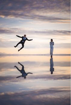When rain covers the ground with water, Bonneville Salt Flats in Utah it gives off the amazing illusion of people walking on water. The reflective surface acts like a giant mirror. Though couple Ethen and Heather had their wedding in Salt Lake City, they decided to shoot their romantic newlyweds photo session at the Bonneville Salt Flats. The conditions made it a chance of a lifetime for photographer Tony Gambino.