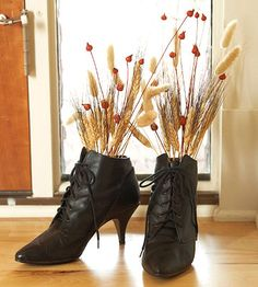 Wicked Witch Boots Decoration     Take a lesson from witches on accessorizing -- black boots are a Halloween must-have. Place a plastic foam ball inside each boot. Stick stalks of wheat and other dried foliage into the foam balls so the foliage sticks out the tops of the boots. Set the boots near the front door to warn everyone that a witch is near.