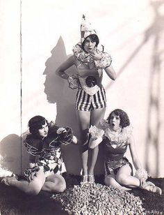 Ohmigod, I want to make the standing girl's outfit!  Vintage circus cosplay anyone?