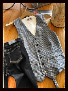 Hand-tailored seersucker vest with vintage accent button for your favorite guy… Oh so NOLA!