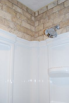 Tile above the shower insert - love it and looks great with shower curtain opened or closed!