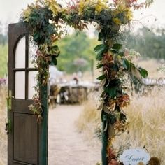 Love the use of vintage doors as decor in weddings