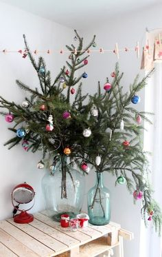 With slightly larger branches, you can even add ornaments. Image from House to Home. | 10 Simple Christmas Decorating Ideas for Small Spaces