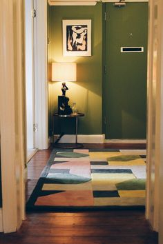 The olive green hallway makeover using Little Greene Citrine. Featuring a gallery wall, Art Deco styling and lots of gilt frames! See the full makeover here - http://www.sarahakwisombe.com/blog/2015/4/15/before-after-hallway-makeover