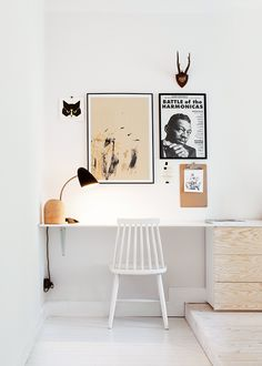 White workspace with black & white prints & untreated wooden storage