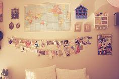 bedroom wall, postcards, map