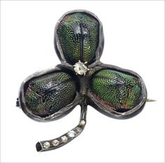 Late 1800s Victorian Scarab Beetle Clover Pin, Paste, Silver (in the online shop)    This is really one of the stranger Victorian brooches I've come across.  The clover is a very typical and very domestic Victorian motif.  To incorporate scarabs, which were usually used in Victorian Egyptian Revival jewelry, is unexpected, and a little odd.  But this is why the Victorians were such great designers.  This jeweler took a trendy, but overused, motif like the clover, and livened it up with some…