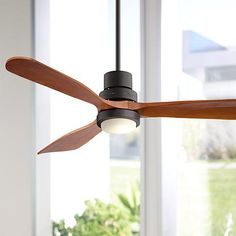 This oil-rubbed bronze ceiling fan comes with an integrated LED downlight and solid wood walnut finish blades.
