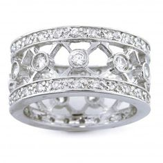 Lattice wedding band. I would prefer it in a tarnished gold.