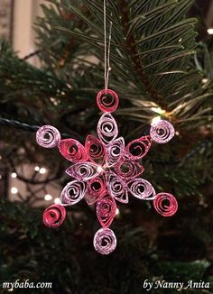 An easy quilled snowflake Christmas Decoration.  A great craft for older children and teens.