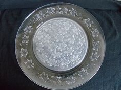 This large roundserving platter was made by Princess House in the 1960s-1980s. It is in the Fantasia pattern.This cake platefeatures a frosted poinsettiafloral pattern in the center of the platter. There is a matching poinsettia floraldesignci...