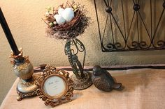 love decor with birds nests... sit on top of candle holder