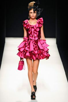 Moschino. I think this is wonderfully tacky and i would have SO much fun in this outfit