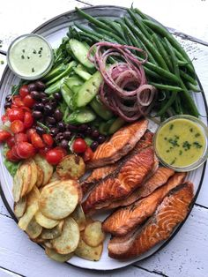 Heres my SPRING NICOISE SALMON SALAD. Im a gal that loves an entree platter theres something for everyone. Its ideal if you are loving seafood or observing Lent. Niçoise eating with a Salmon Nicoise Salad, Salade Nicoise Recipe, Nicoise Salad Dressing, Salmon Salad Recipes, Clean Eating, Healthy Eating, Healthy Food, Comida Keto, Cooking Recipes