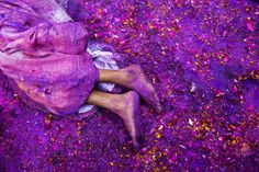 A Hindu widow lies on a sludgy ground filled with a mixture of colored powder, water and flower petals during celebrations to mark Holi, the Hindu festival of colors, at the Meera Sahabhagini Widow Ashram in Vrindavan, India, March 3, 2015. After their husband's deaths many of the women in the ashrams have been banished by their families, for supposedly bringing bad luck, while some move voluntarily to and around the town where devotees believe Lord Krishna was born.