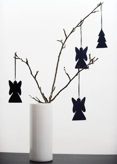 angels. No instructions but no big deal. A branch, some cut-outs, string and a vase! I really love this and it's so simple yet elegant!