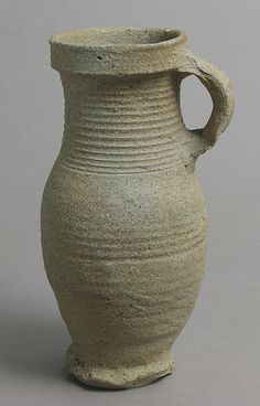 Jug  Date: first half 14th century Geography: Made in Siegburg, Lower Rhineland, Germany Culture: German Medium: Proto-stoneware, unglazed Dimensions: Overall: 7 15/16 x 4 3/16 x 3 11/16 in. (20.2 x 10.6 x 9.3 cm) Classification: Ceramics Credit Line: Gift of Anthony and Lois Blumka, 1991 Accession Number: 1991.471.3