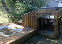 Another fine example of a cool dog house with a swimming pool.